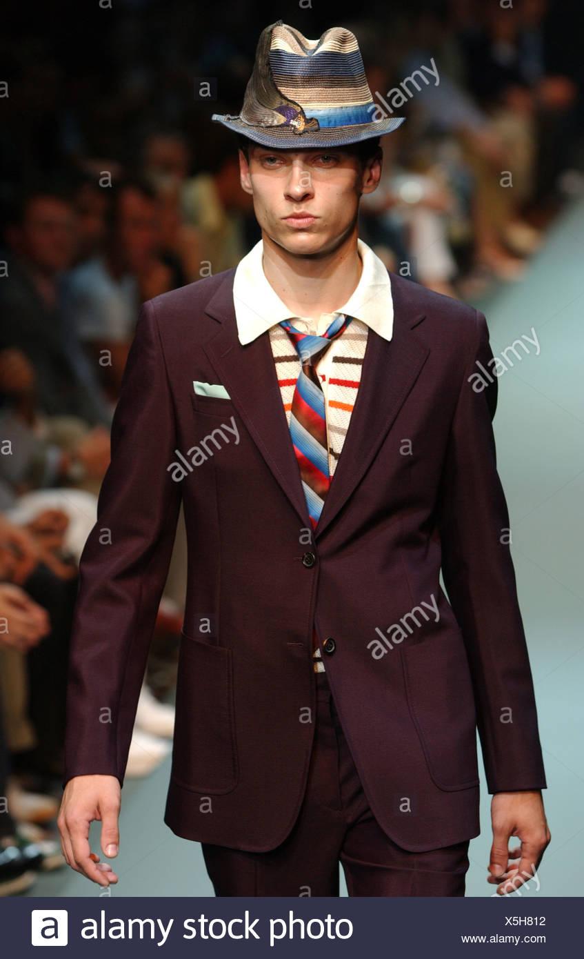 496e55e6b8b1 Prada Menswear Ready to Wear Spring Summer Model short brown hair wearing  blue beige and brown striped hat