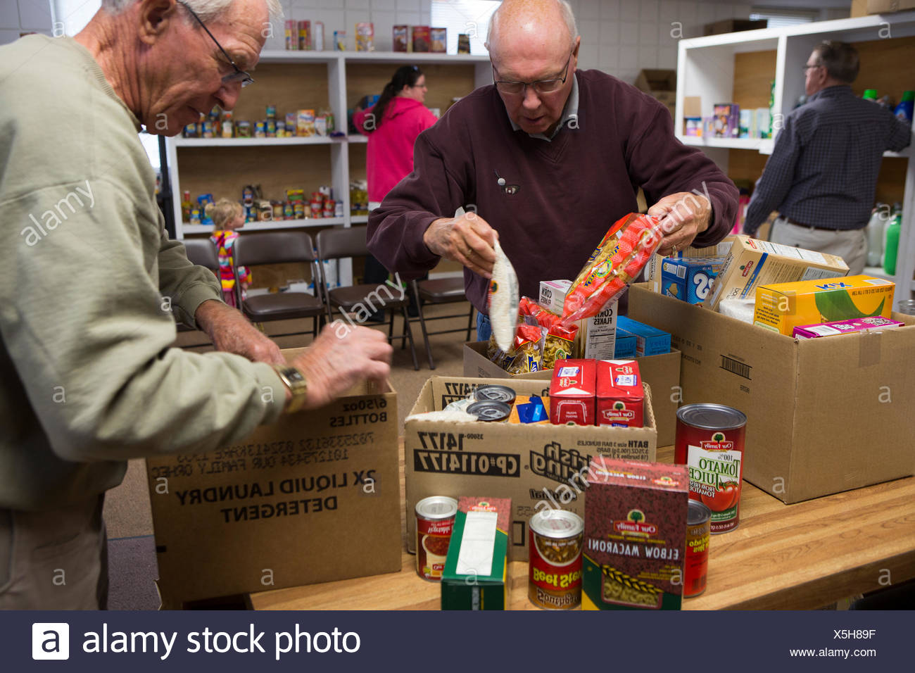 Volunteers pack boxes of donated food at the Mitchell County Food Bank in Osage Iowa. Stock Photo