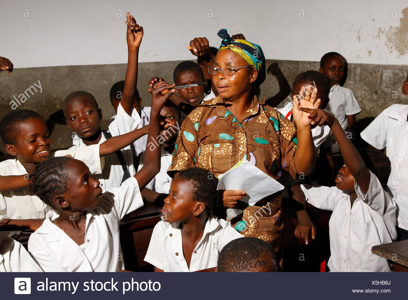 Teacher and school children in school uniform during class, Kinshasa, Congo - Stock Image