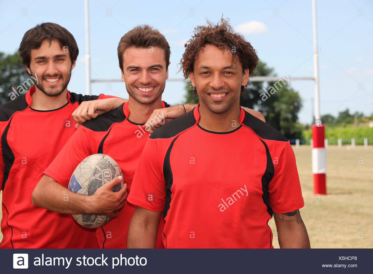 mates at rugby Stock Photo