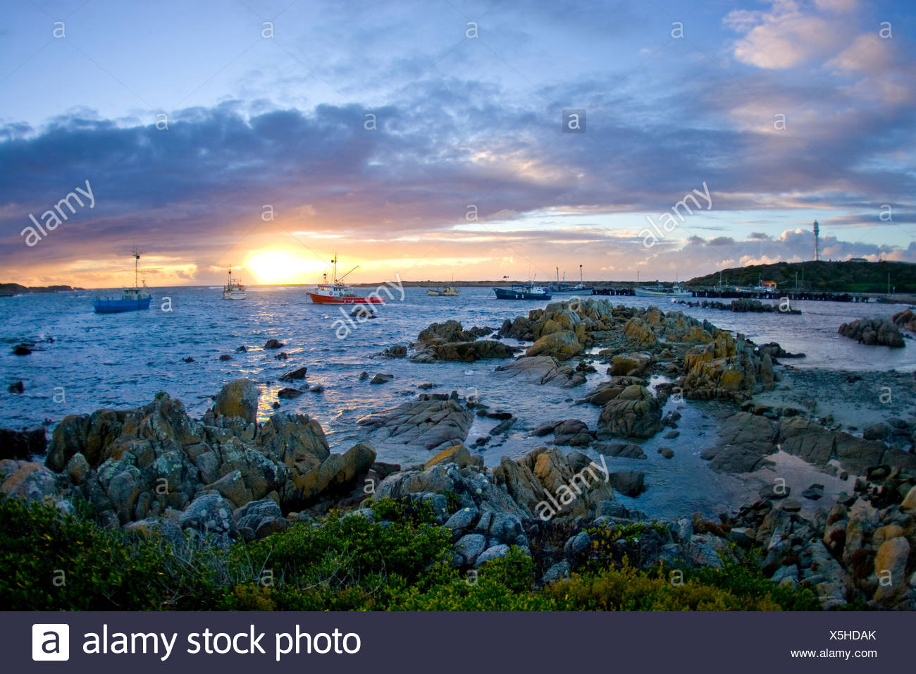 Sunset over fishing boats, King Island, Australia. - Stock Image