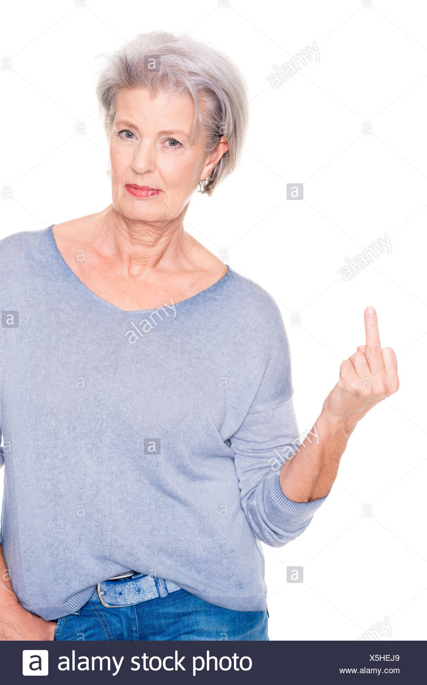 woman showing middle finger - Stock Image