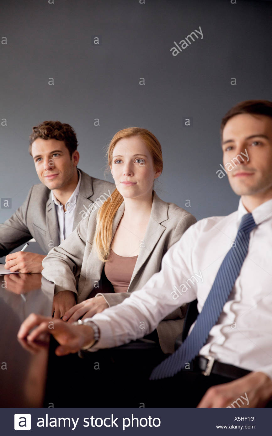 Young business professionals attending presentation - Stock Image