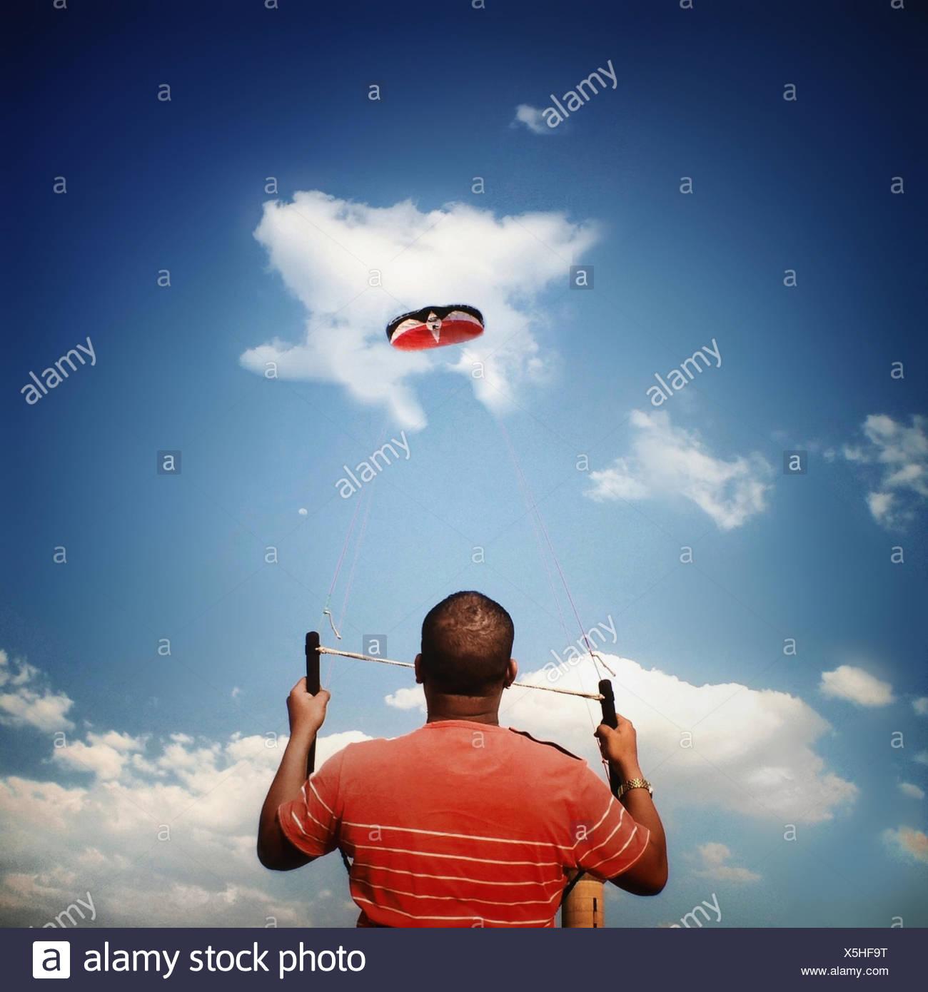 Man flying kite - Stock Image