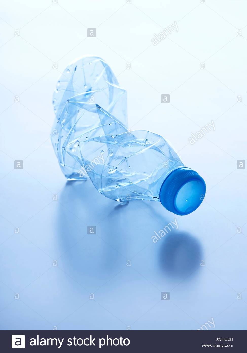 Crushed plastic bottle, studio shot. - Stock Image