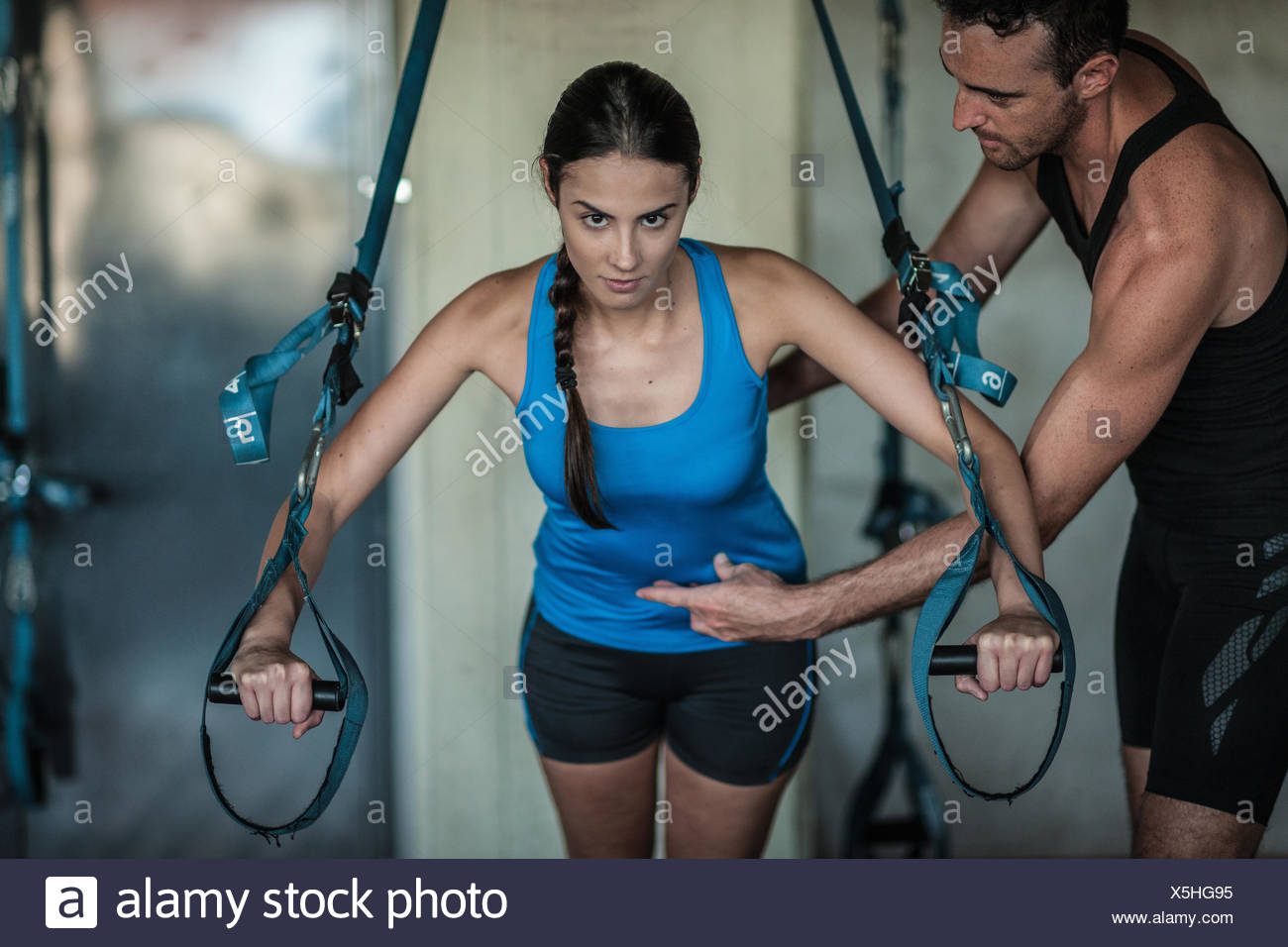 Young woman weight training - Stock Image