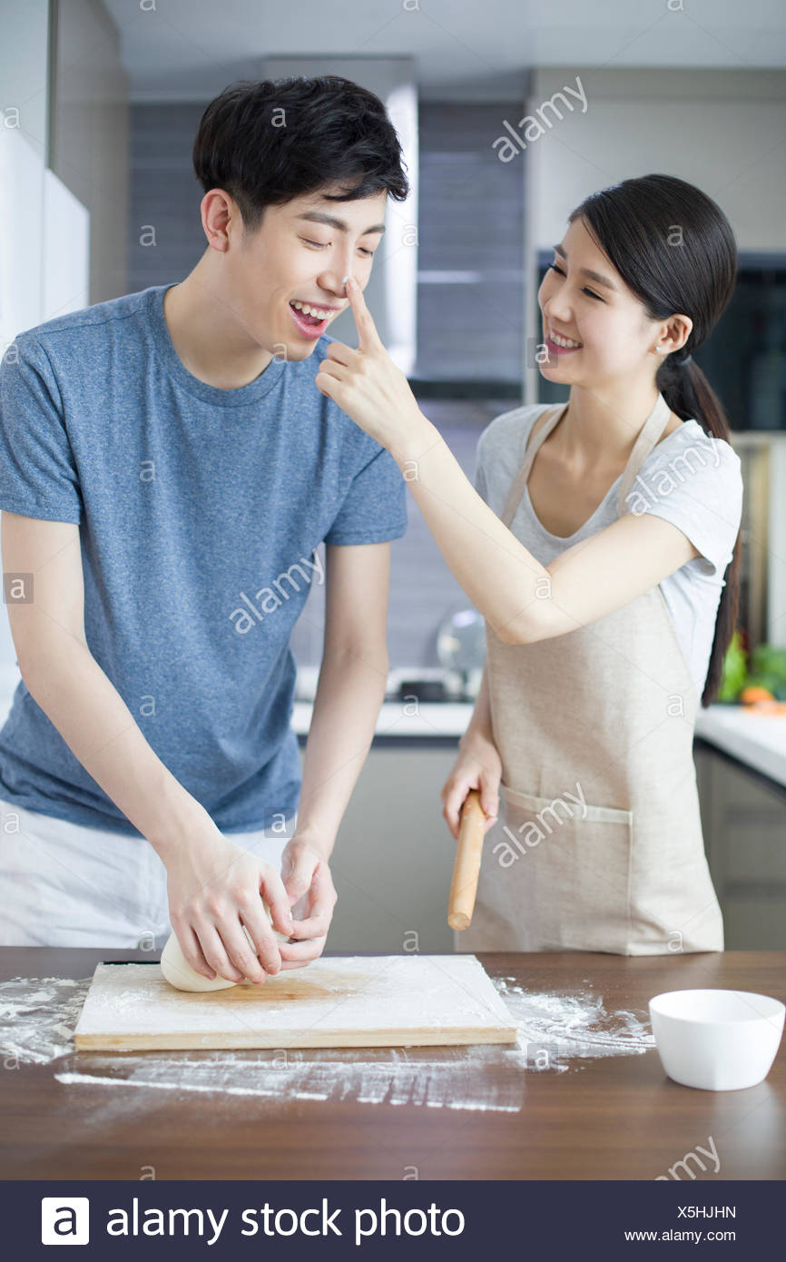 Happy young Chinese couple cooking in kitchen Stock Photo: 278826961 ...