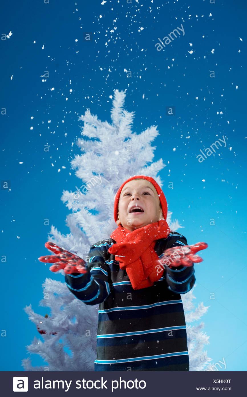 boy,winter,snowing - Stock Image