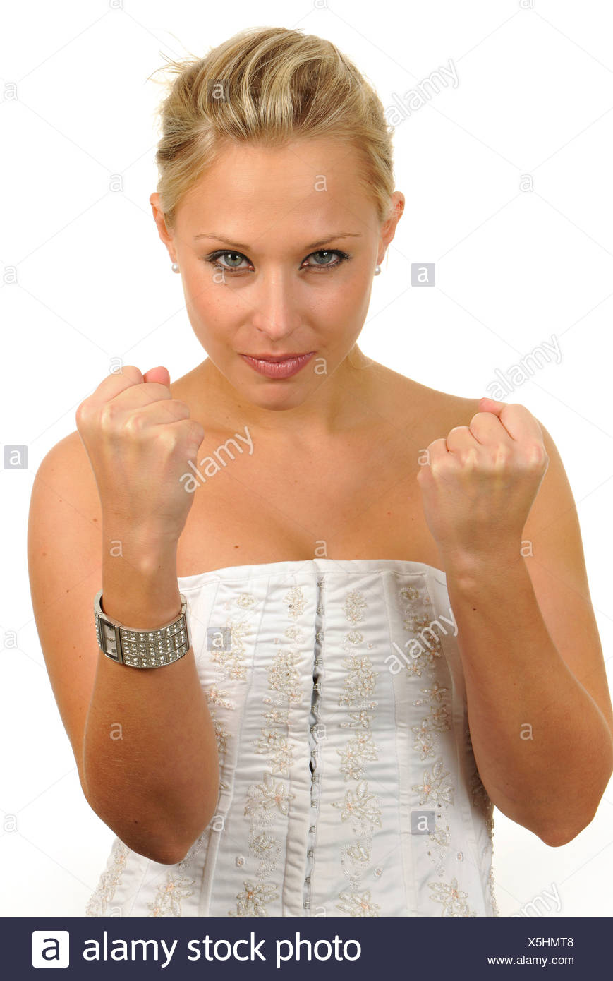 Young woman, angry, annoyed, clenched fists - Stock Image