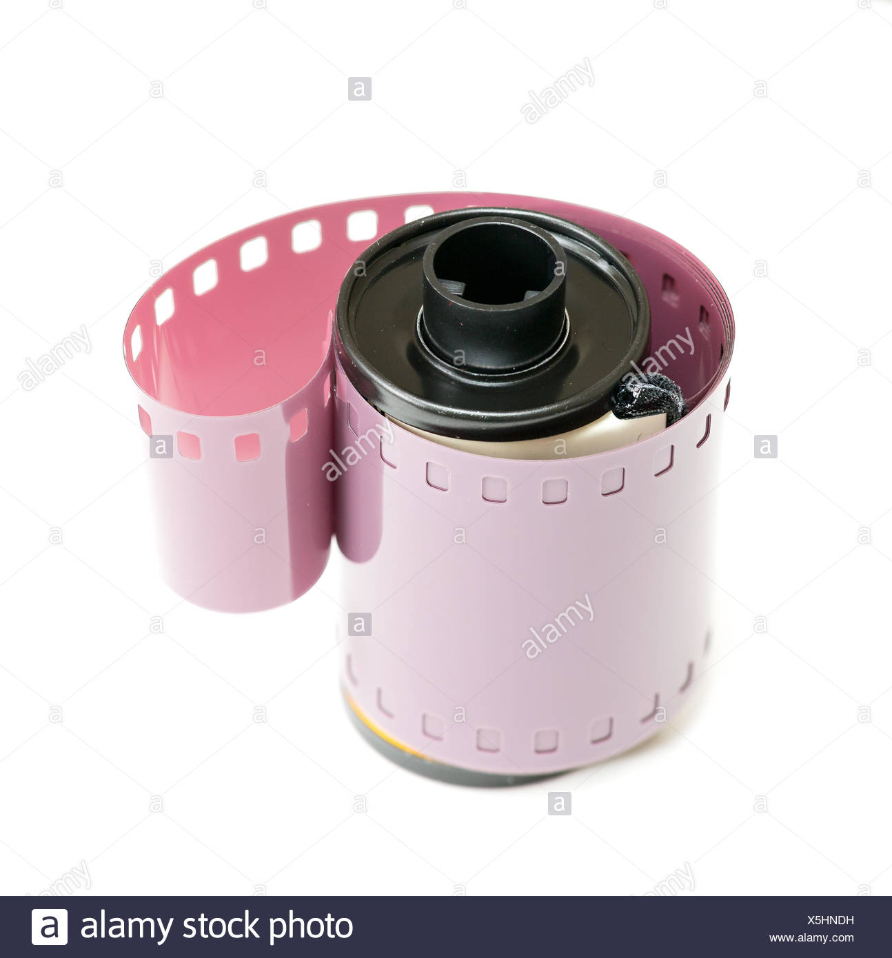 35mm film canister and coiled negative Stock Photo