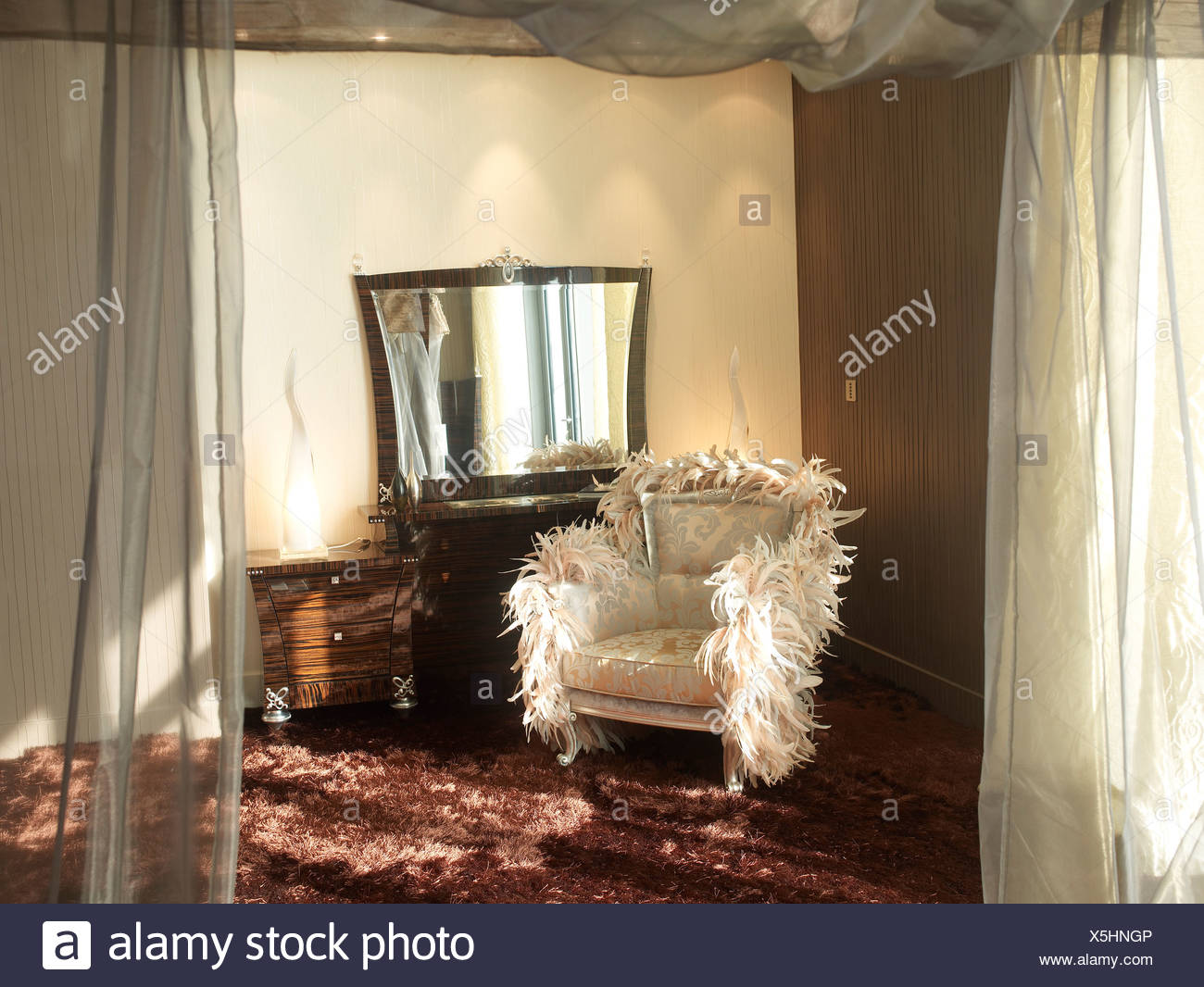 Luxurious chair and vanity in a Dubai-style bedroom - Stock Image