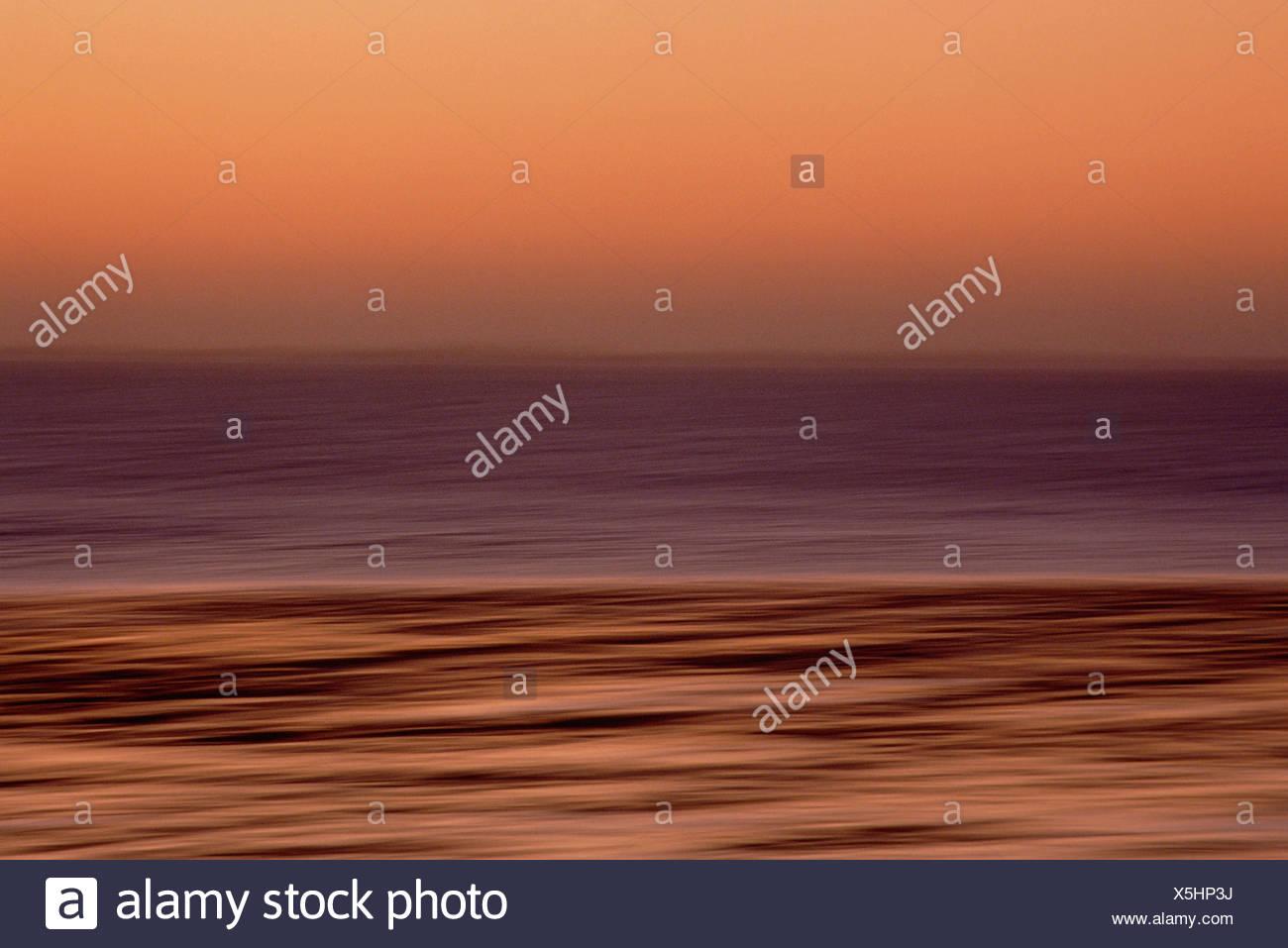 Dawn over ocean horizon. Photographic art abstract. - Stock Image