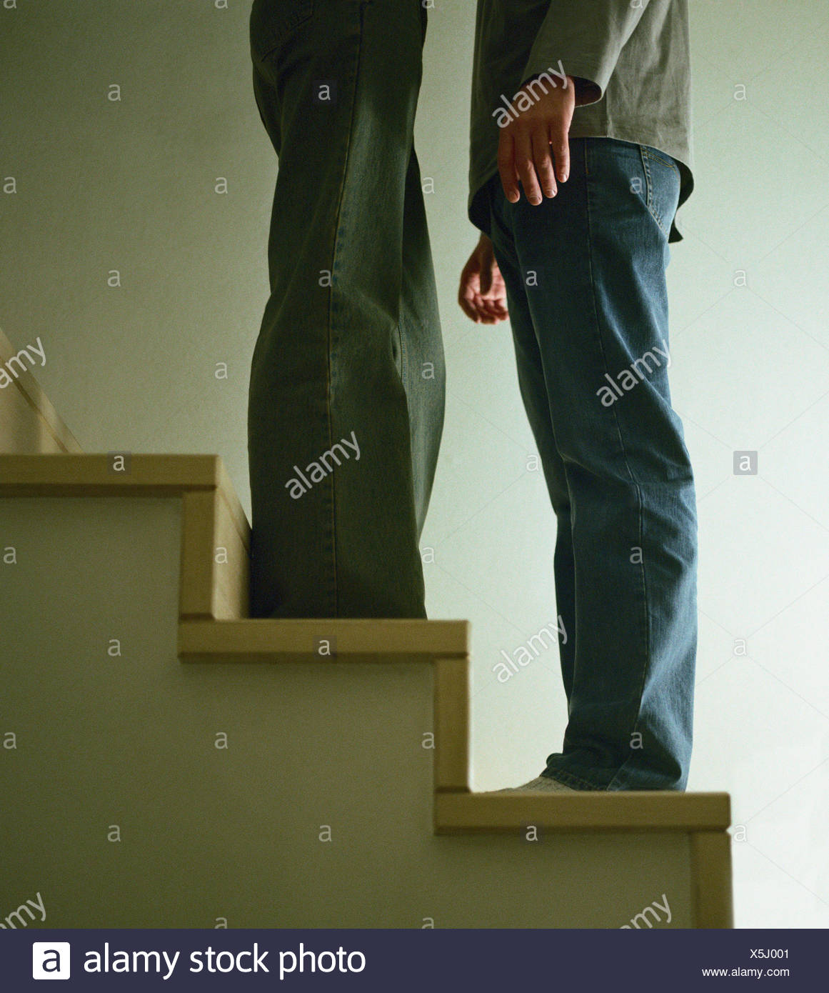 Couple on stairs, lower section - Stock Image