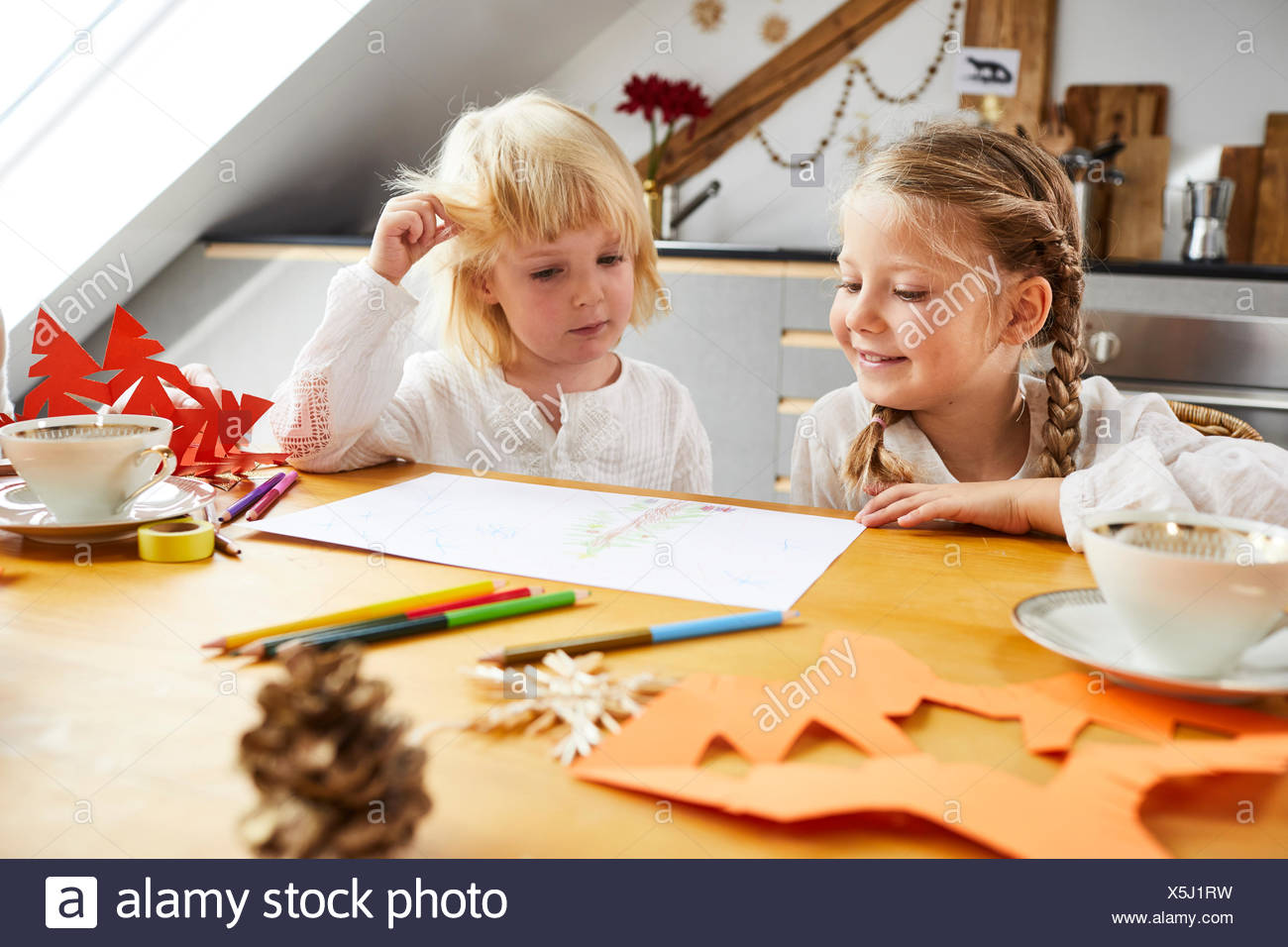 Two girls cozy at home while crafting, portrait - Stock Image