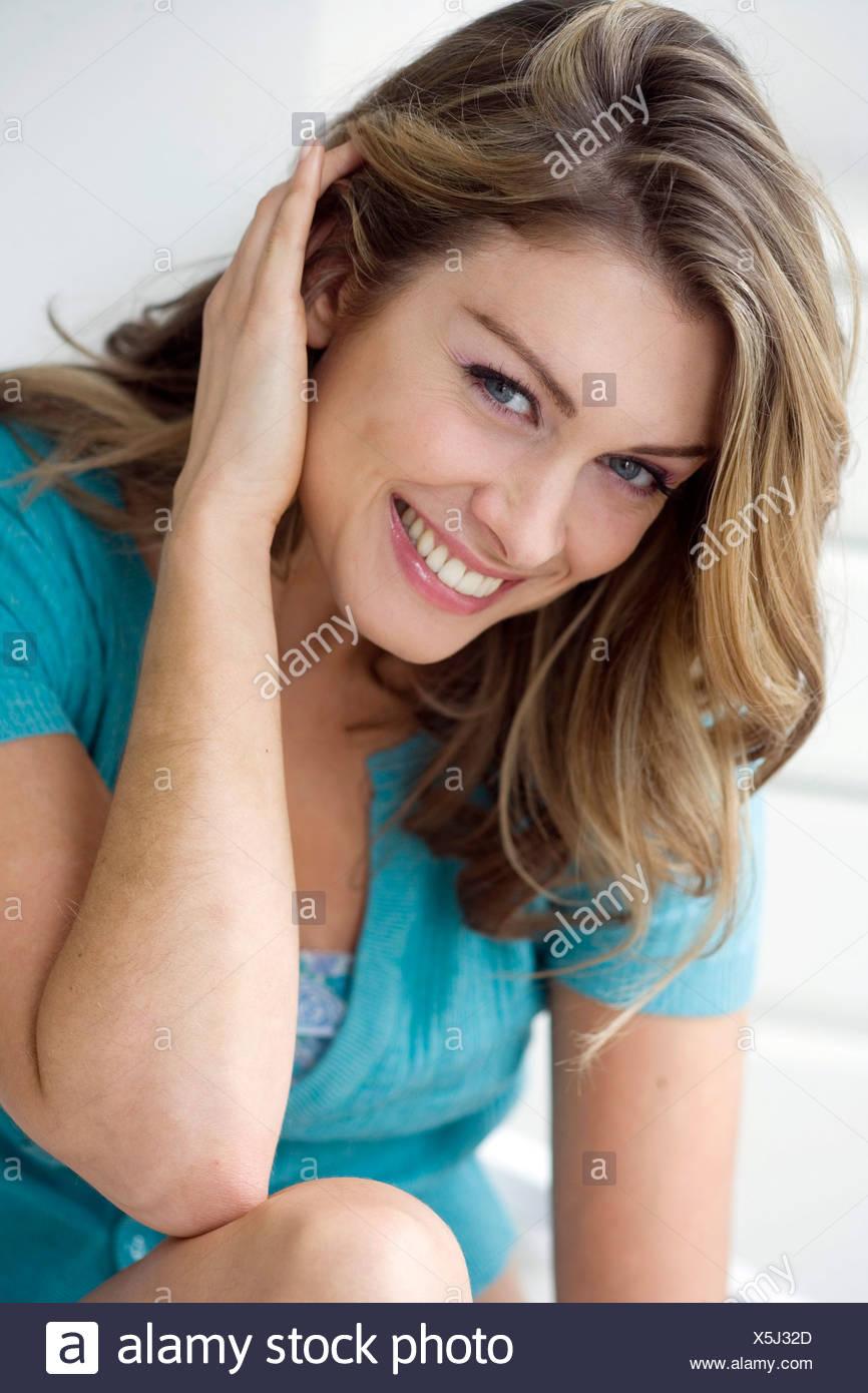Female Tucking Hair Behind Ear Stock Photo Alamy