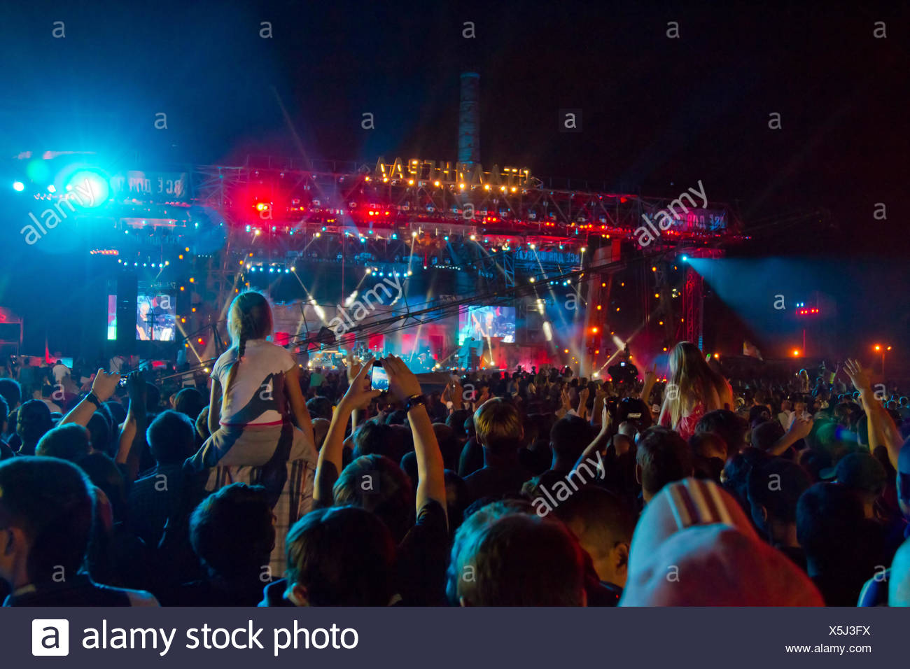 fans of the rock in the crowd on a tank shows Stal - Stock Image