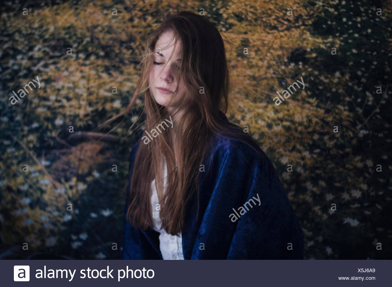 Portrait of young woman with closed eyes - Stock Image