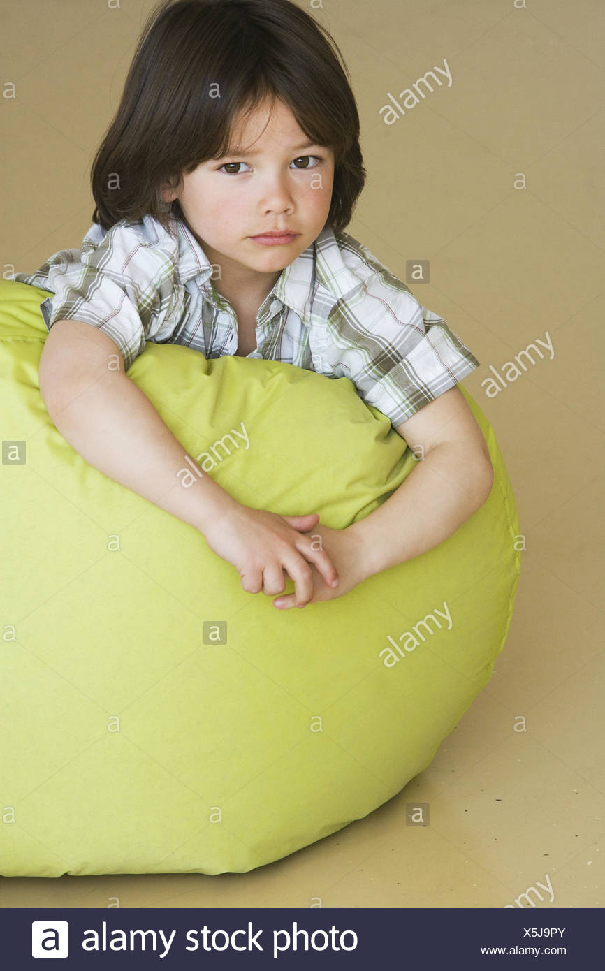 Brilliant Preschool Boy Laying On Bean Bag Stock Photo 278842003 Alamy Caraccident5 Cool Chair Designs And Ideas Caraccident5Info