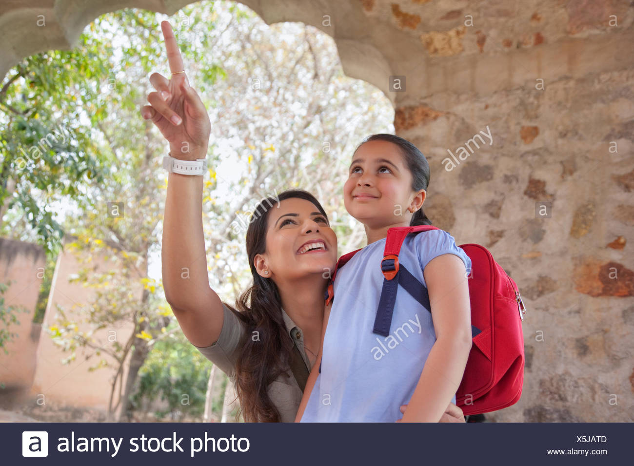 Woman pointing something out to daughter - Stock Image