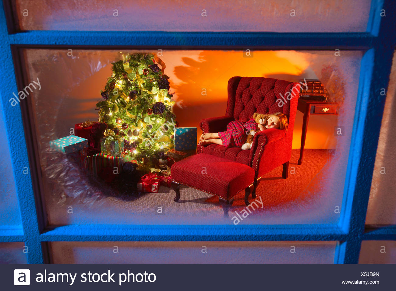 Girl sleeping in house decorated for Christmas Stock Photo