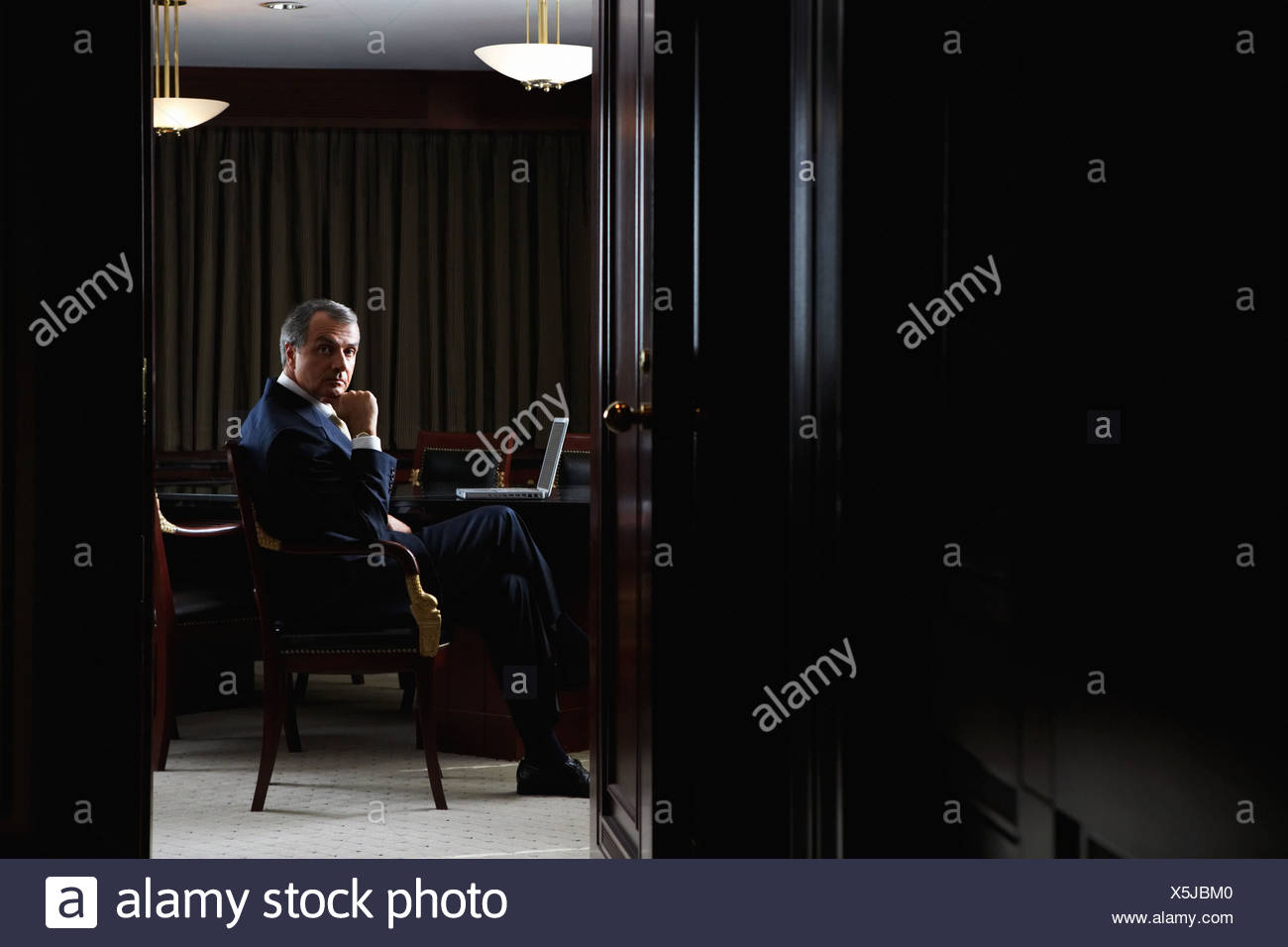 Portrait of a ceo in his office - Stock Image