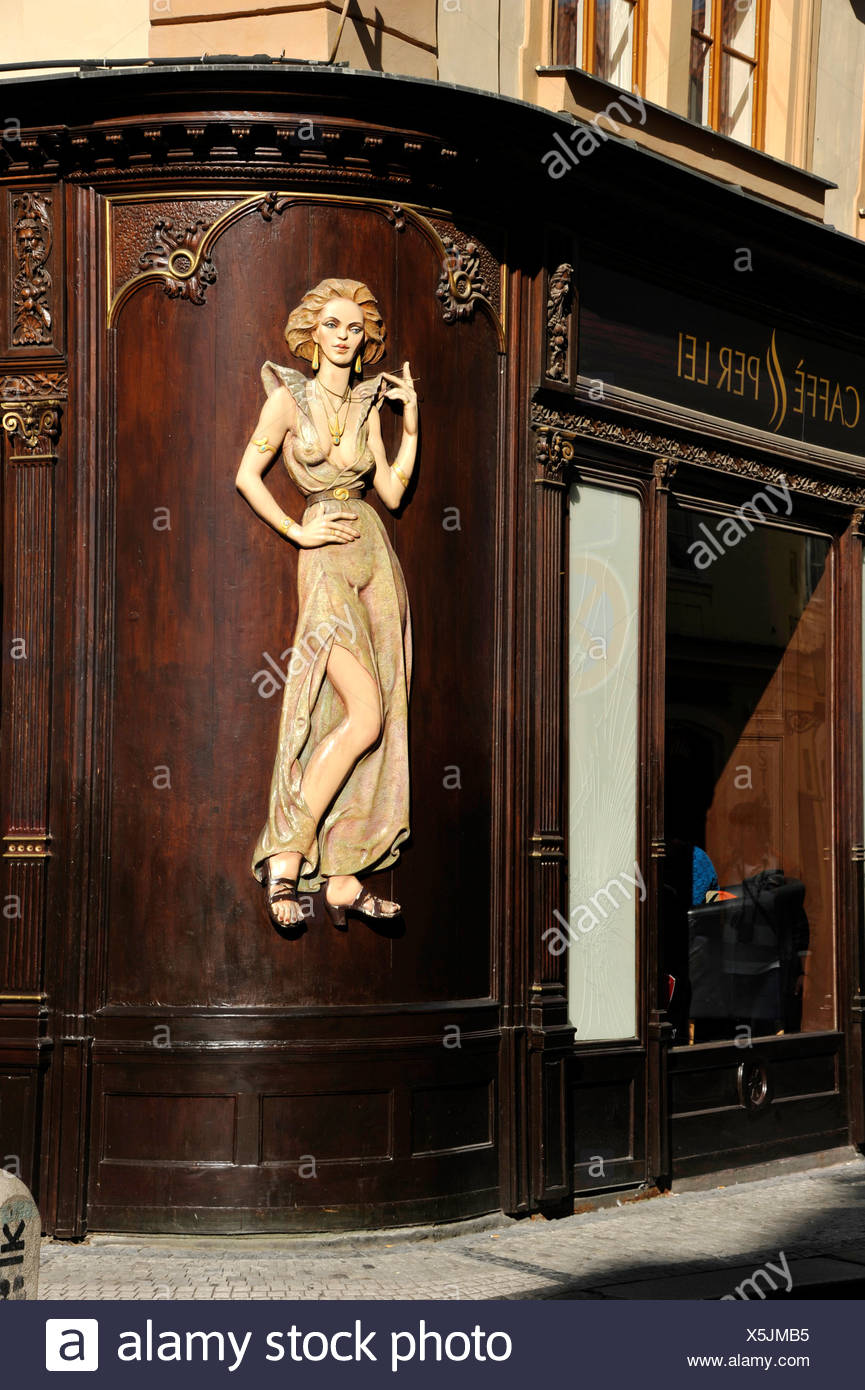 Art Nouveau house emblem of a lascivious woman, wood relief on the facade of the Caffè per Lei Cafe, historic district, Prague Stock Photo