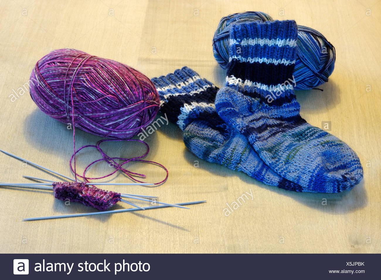 Knitting of socks, wool, knitting needles - Stock Image