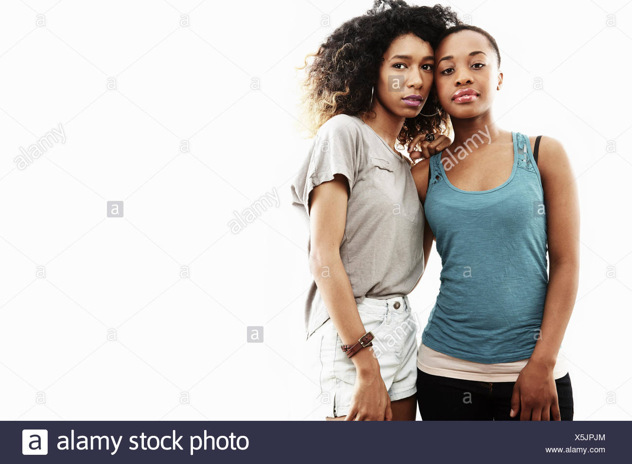 Studio portrait of two young women - Stock Image