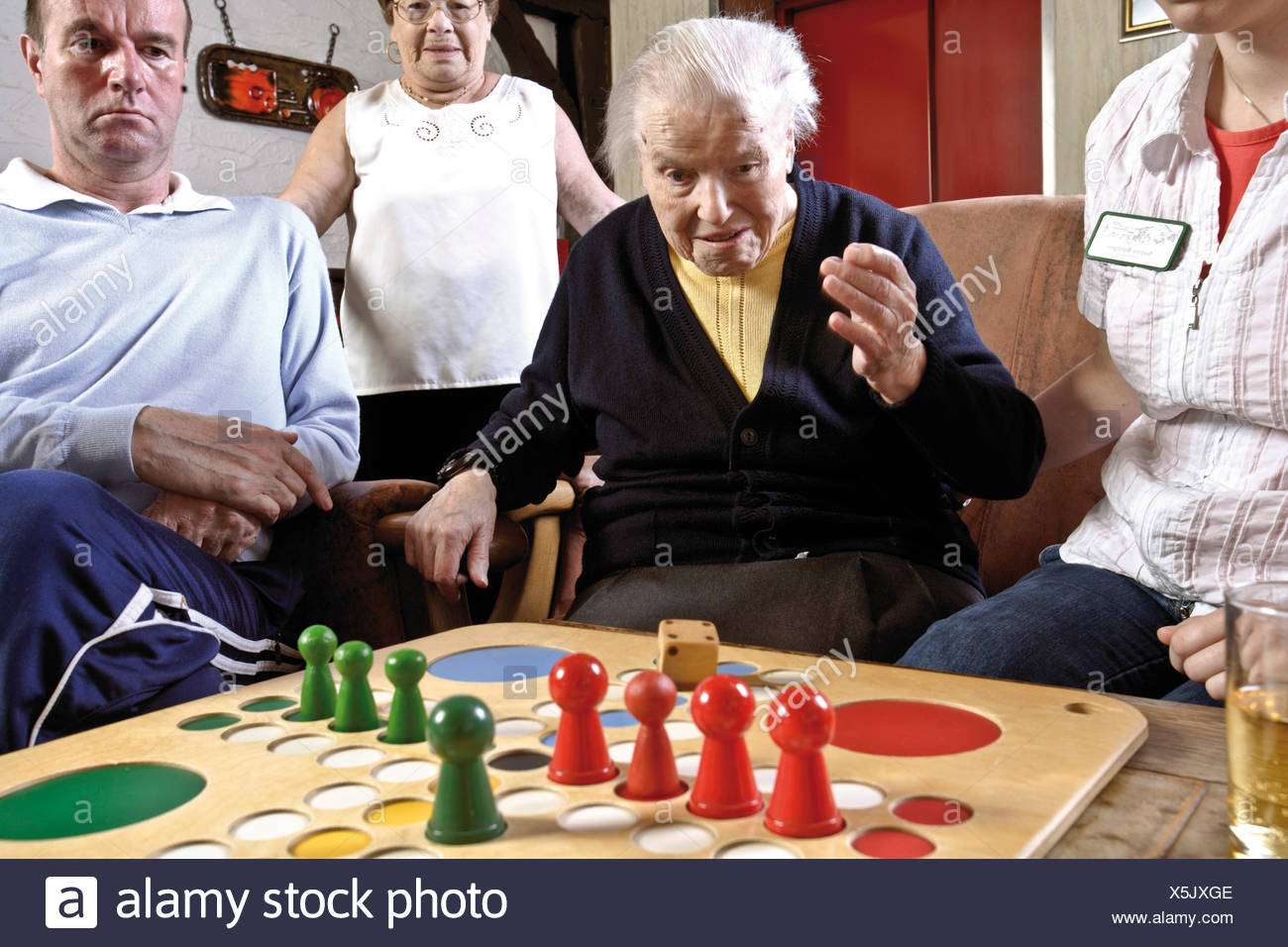 Nurses And Residents Of An Old Age Home Or Nursing Home Playing