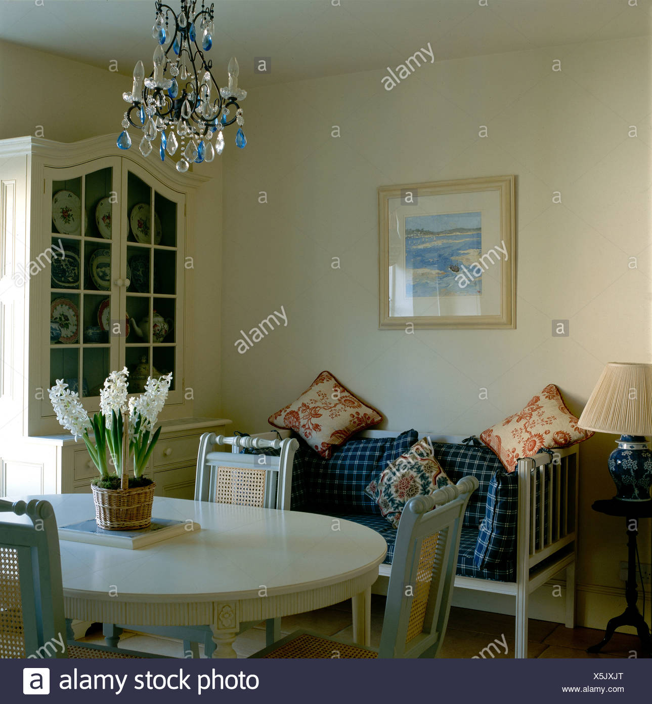 Terrific Glass Chandelier Above Gray Chairs And Oval Table With Pot Dailytribune Chair Design For Home Dailytribuneorg