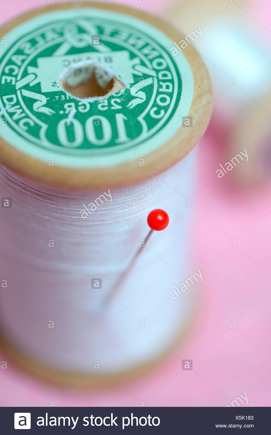 pin and cotton reel - Stock Image