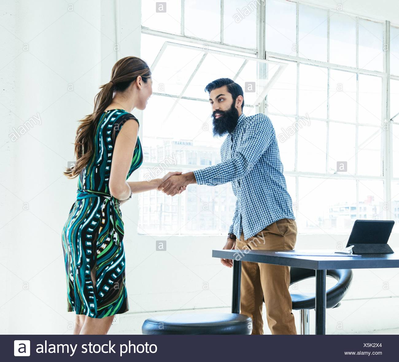 Business people shaking hands at meeting - Stock Image