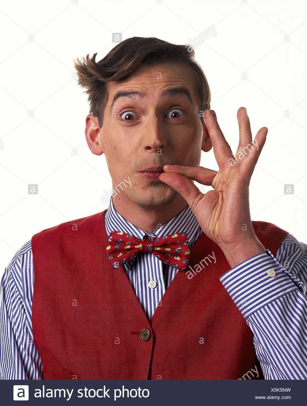 Man, young, page apex, mop hair, shirt, waistcoat, fly, gesture, perfectly, o.k., portrait, Men, studio, cut out, petty bourgeois, becomes stuck, gourmet, very well, exquisitely, very well, well, - Stock Image