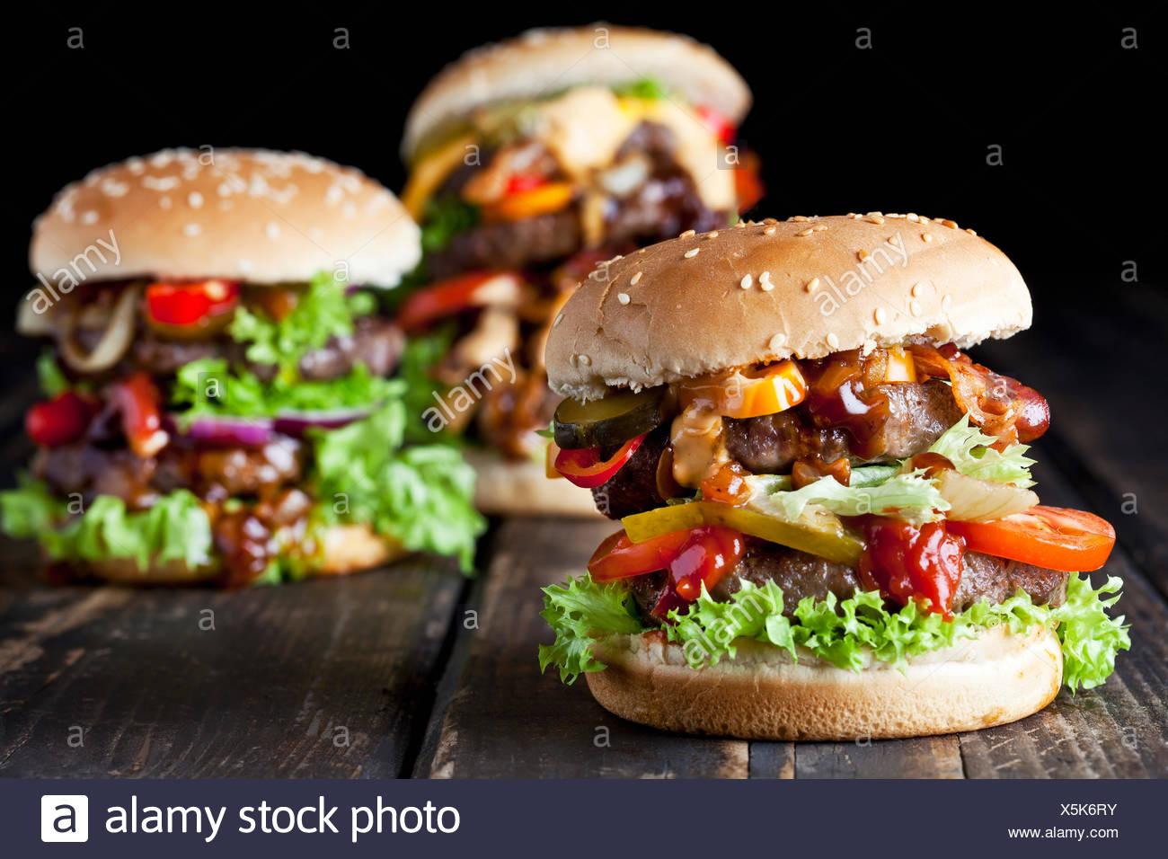 Three double burgers - Stock Image