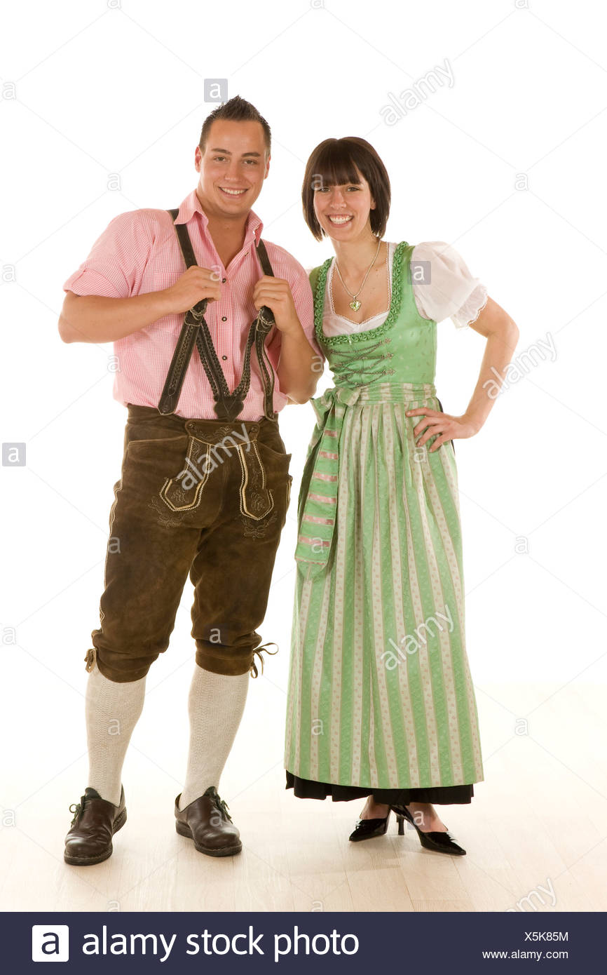 Man and woman in the early twenties wearing traditional bavarian costumes - Stock Image