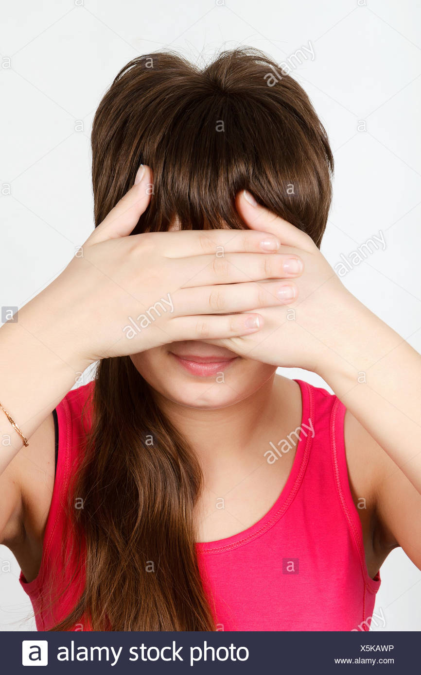 Young attractive girl closes her eyes - Stock Image