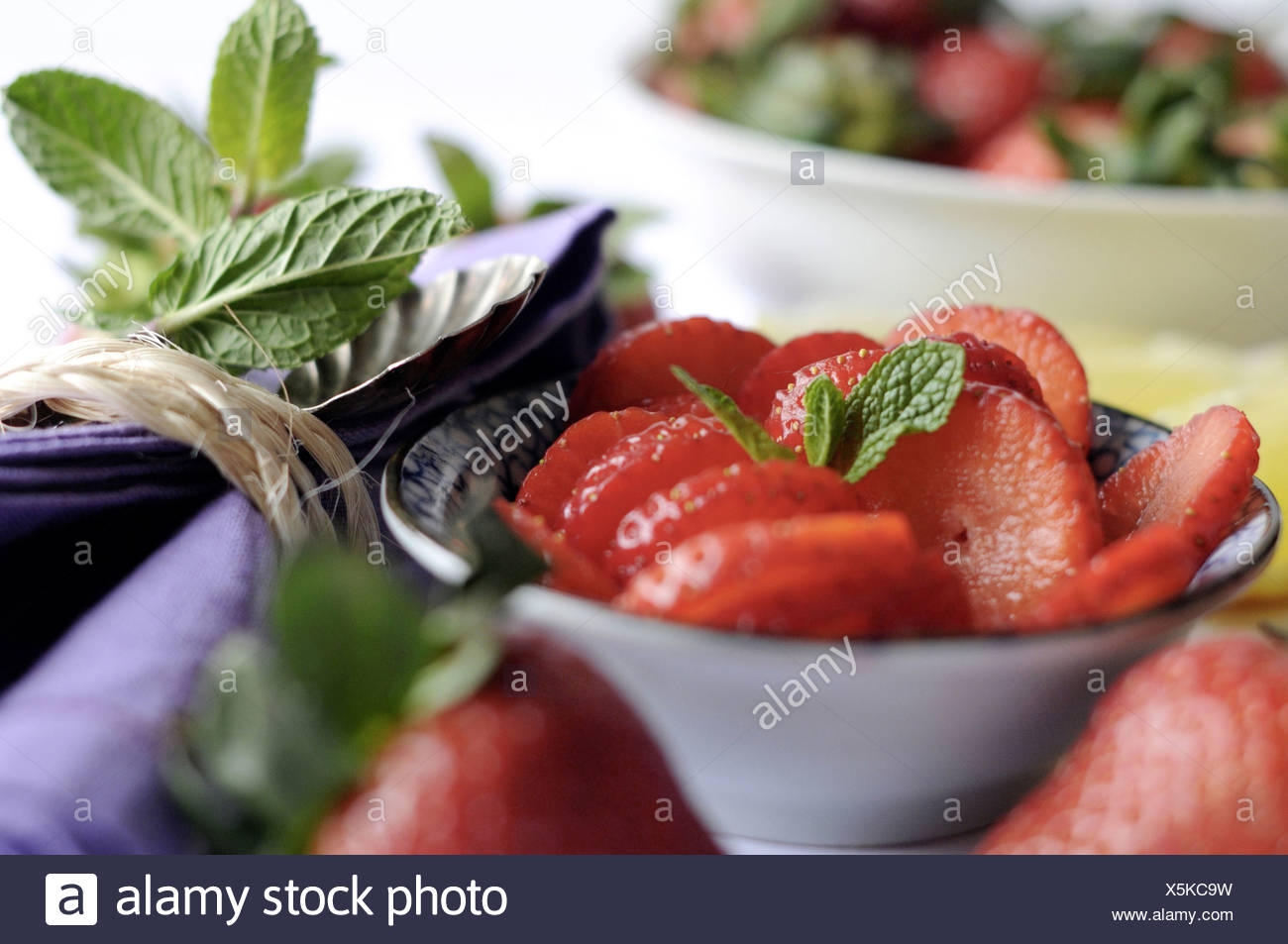 Strawberries with mint - Stock Image