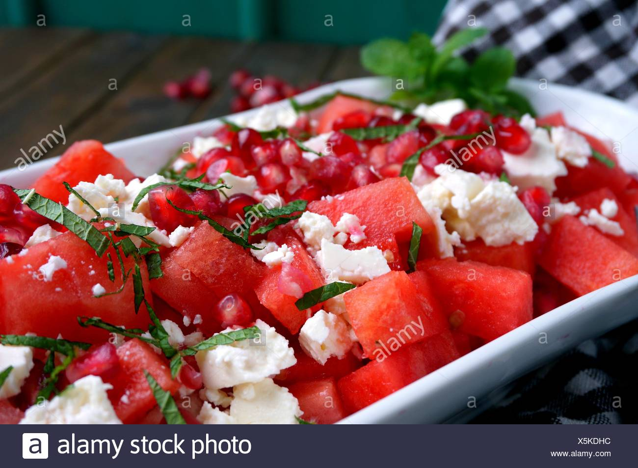 Watermelon salad with feta cheese and pomegranate seeds - Stock Image