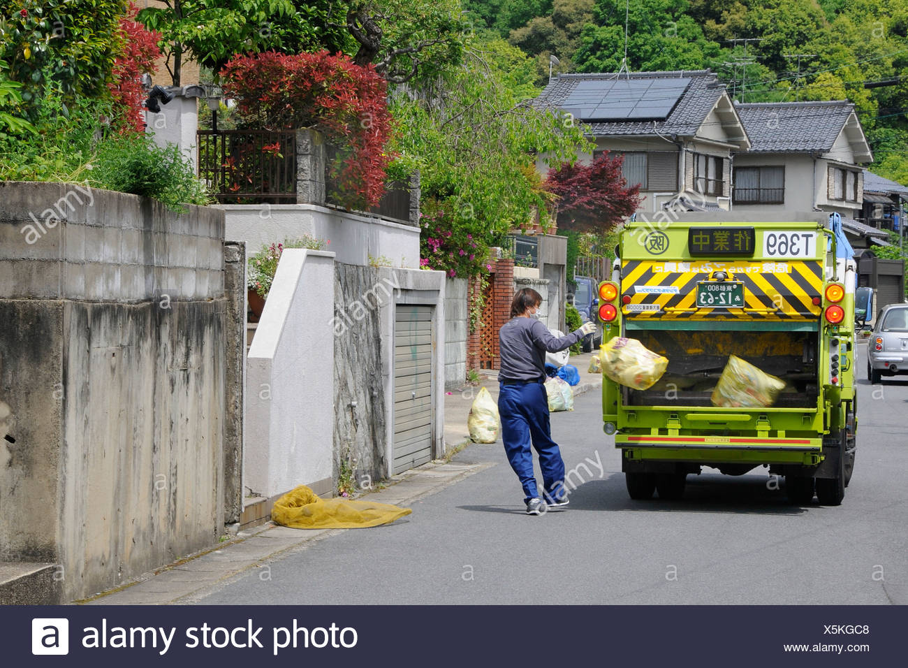 Refuse disposal with small garbage truck, Iwakura, Kyoto, Japan, Asia - Stock Image