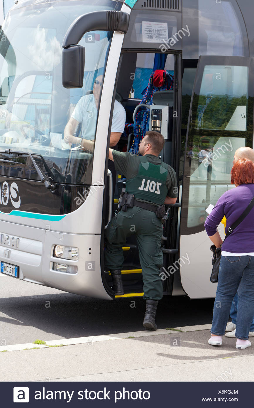 Customs officers inspecting a bus in Berlin Mitte, Germany, Europe Stock Photo