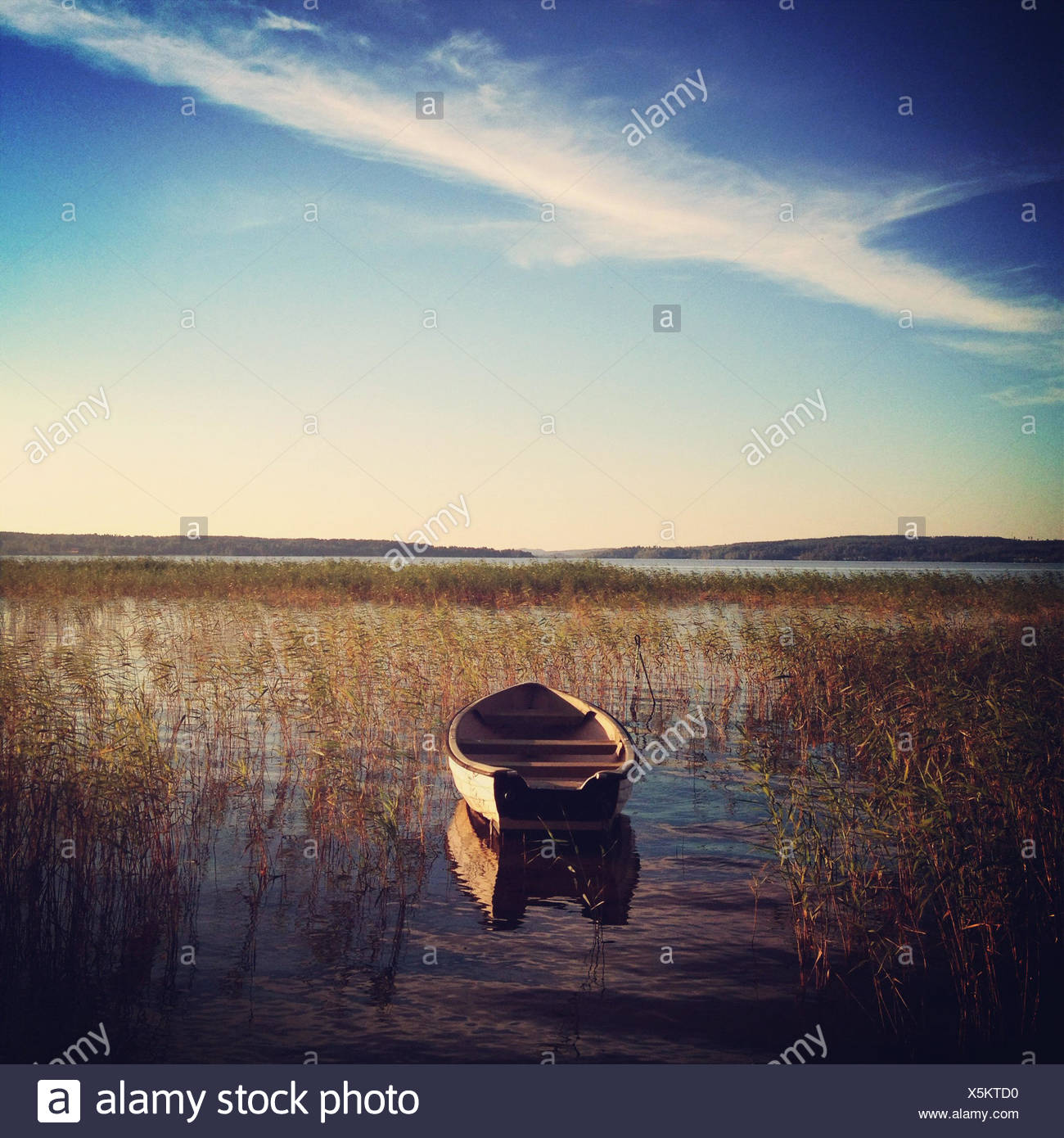 Wooden Rowing boat on lake, Sweden - Stock Image