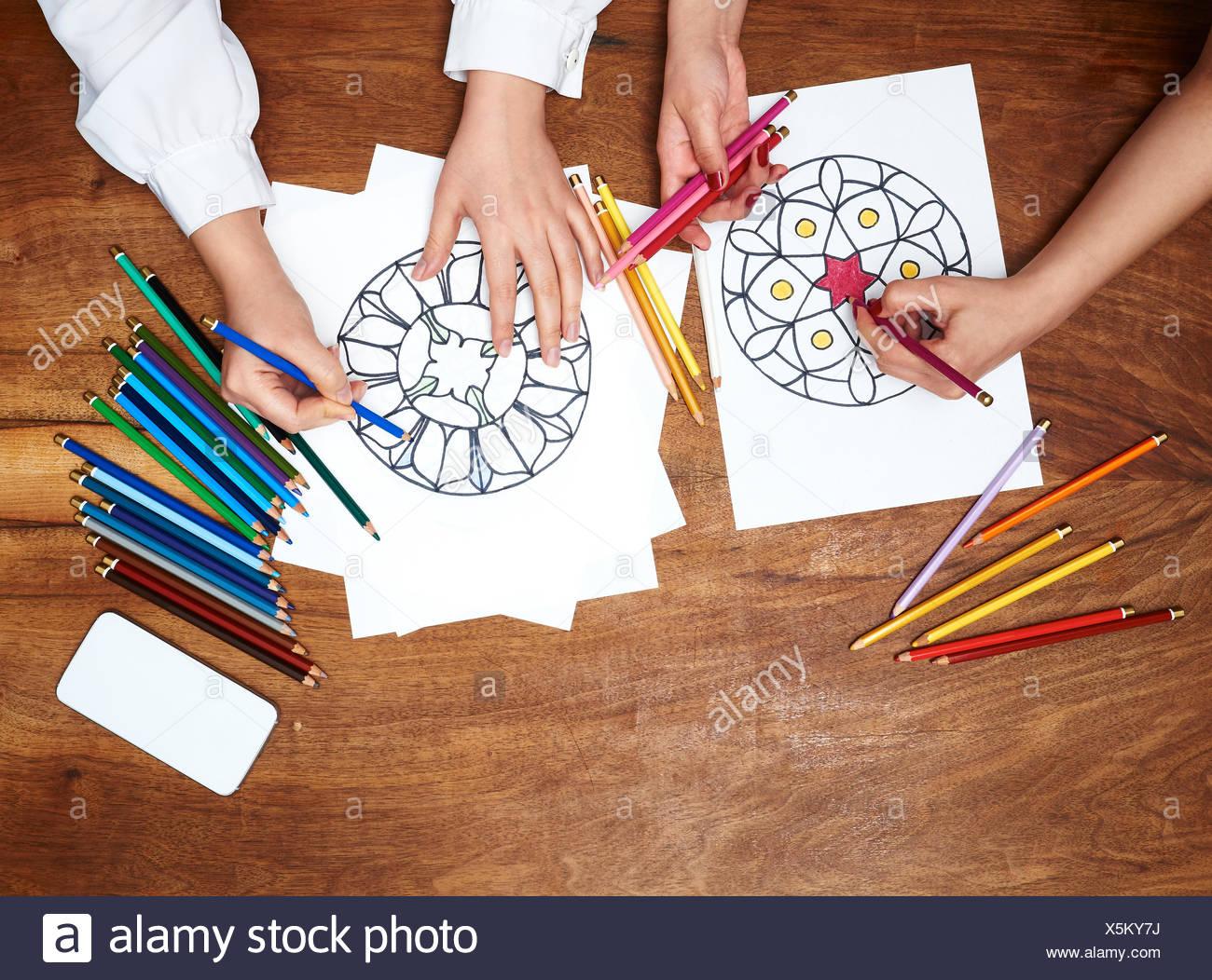Hands drawing mandalas - Stock Image