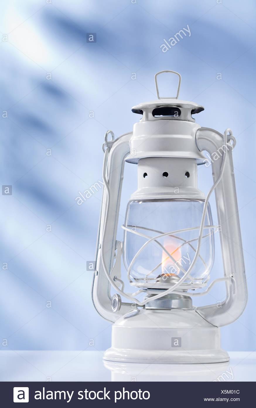 kerosene lamp on blue background - Stock Image