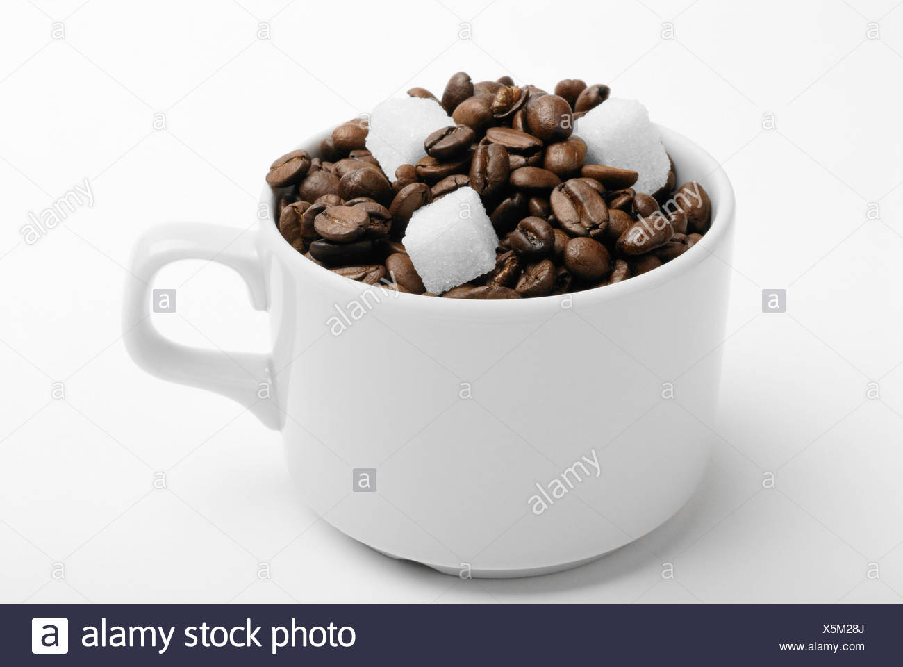 cup with coffee beans and sugar. closeup - Stock Image