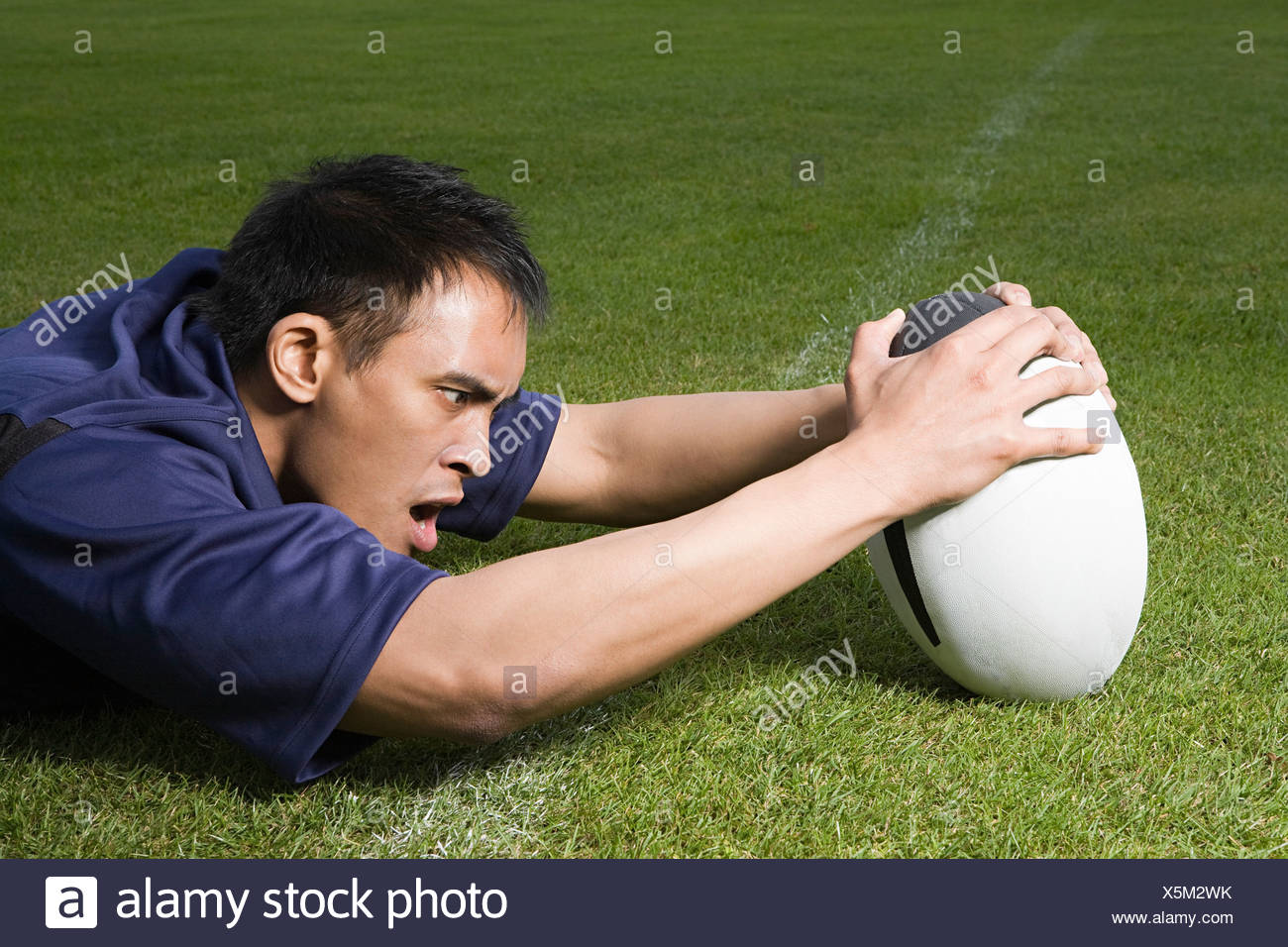 A rugby player scoring a try - Stock Image