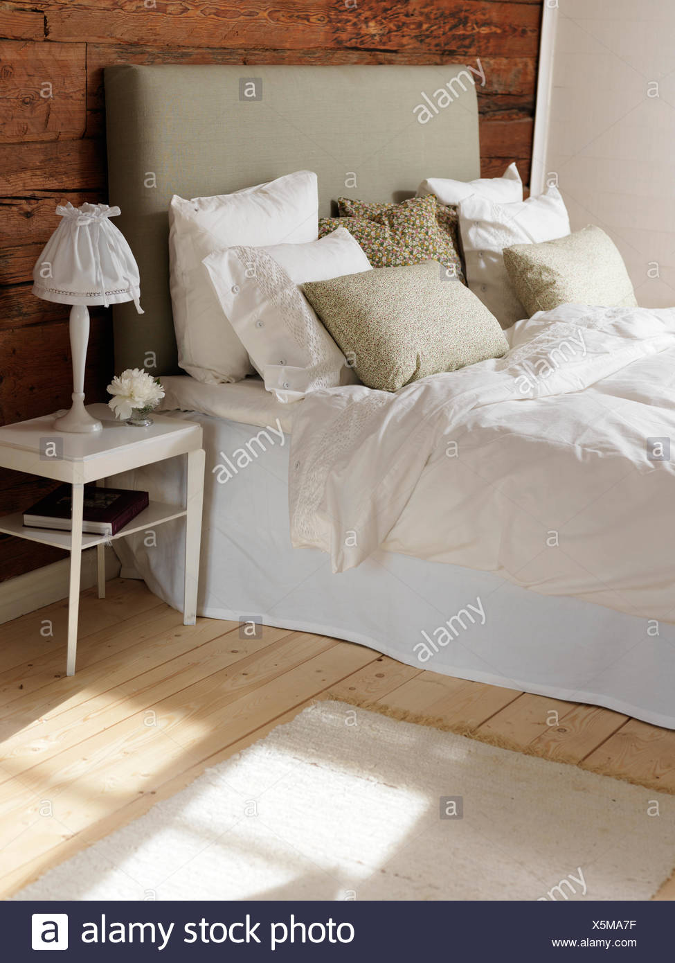 Sweden, Bedroom with wood and white color theme - Stock Image