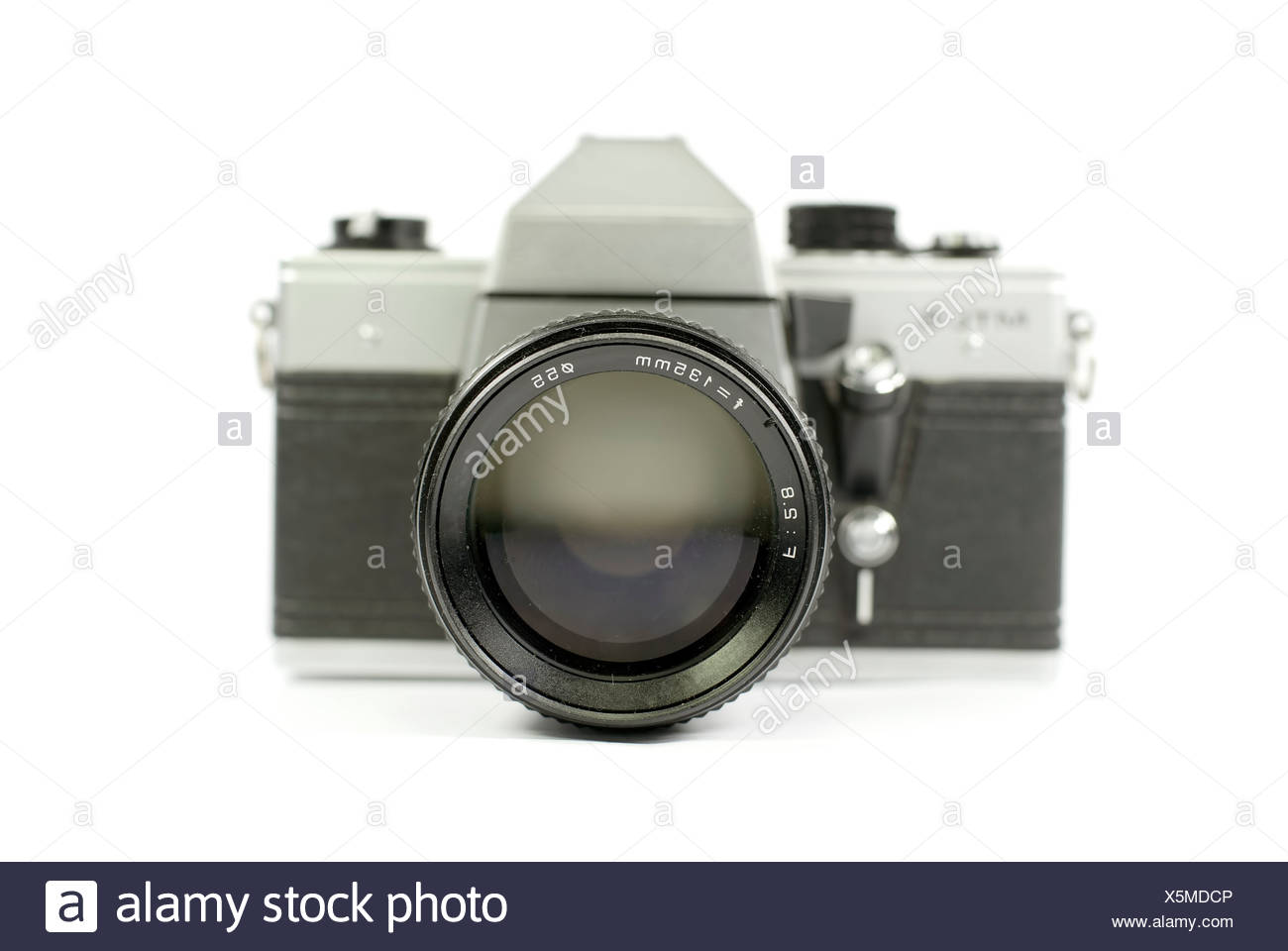 Front view of an old film camera with its telephoto lens