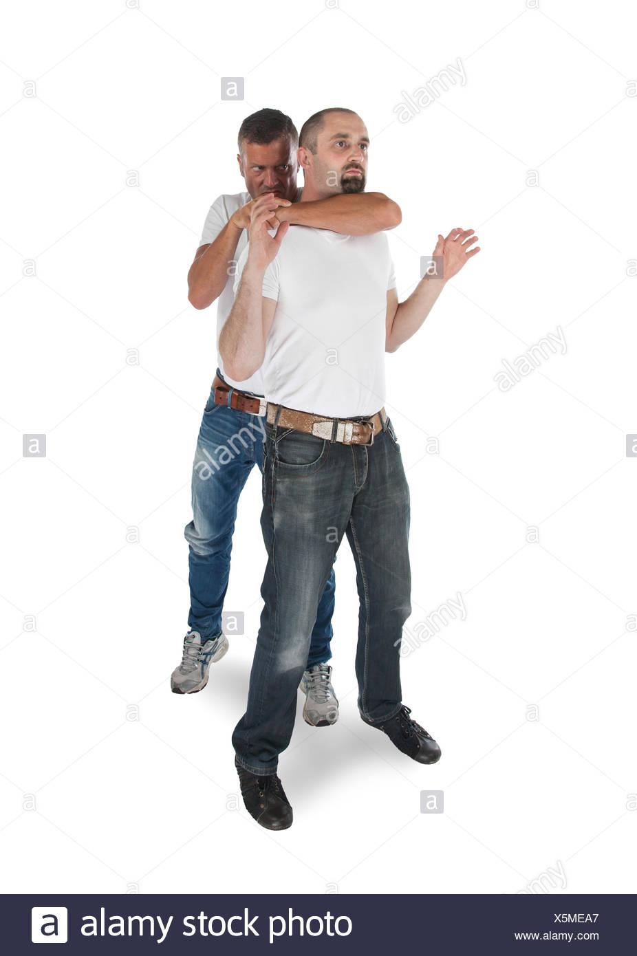 Man choking other man - Stock Image