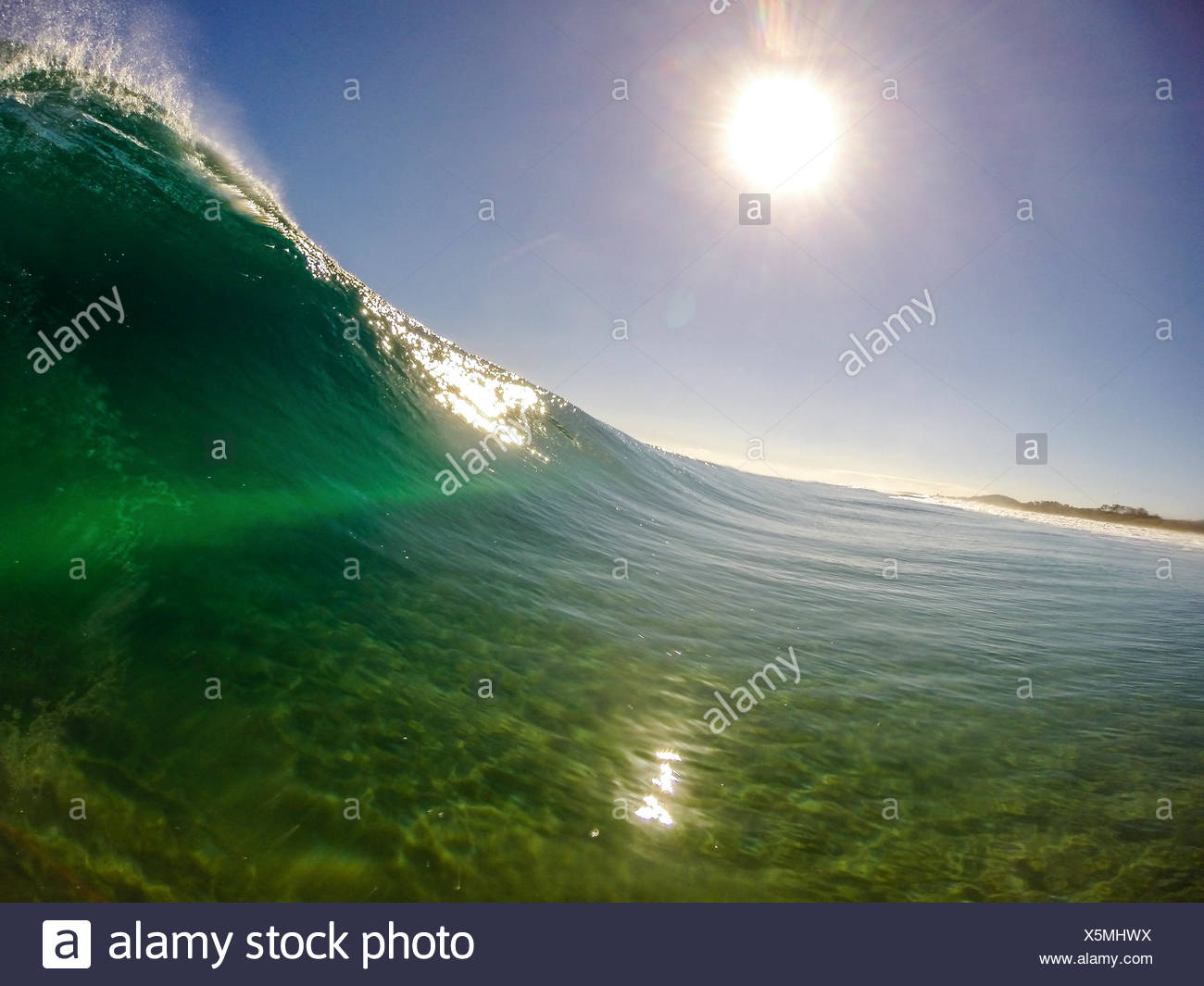 Australia, New South Wales, Wave on Black Rocks Beach - Stock Image