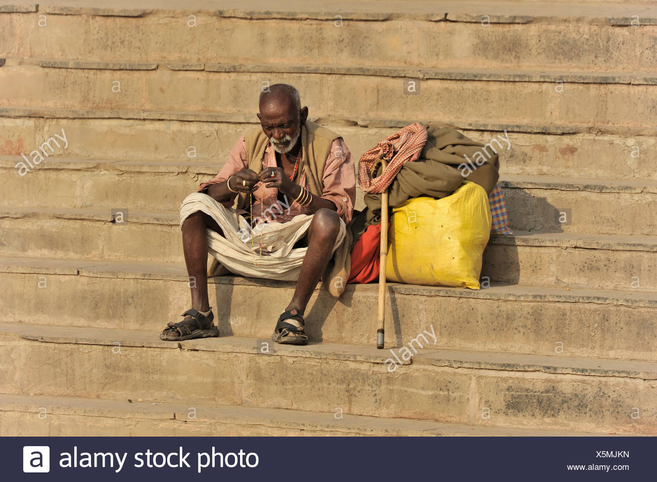 Creditors on the ghats or steps on the banks of the Ganges in Varanasi, Benares, Uttar Pradesh, India, South Asia - Stock Image